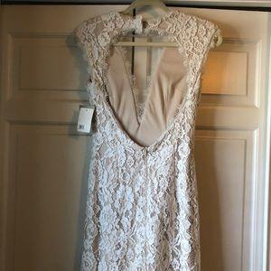 white above the knee, open back white dress